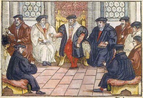 Marburger Religionsgespräch [kolorierter Holzschnitt 1557]. Es fand vom 1. bis 4. Oktober 1529 auf Einladung des Landgrafen Philipp des Großmütigen auf dem Marburger Schloss zwischen Martin Luther, Huldrych Zwingli sowie anderen namhaften Reformatoren statt und sollte beide Zweige der Reformation für eine gemeinsame Linie gewinnen. Aber das Religionsgespräch gilt als der Zeitpunkt, seit dem die lutherische und die schweizerische (reformierte) Reformation endgültig getrennt waren.