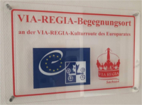 Schild des  VIA REGIA Begegnungsraum - Landesverband Sachsen e.V
